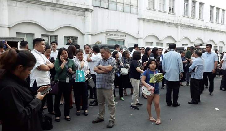 Look: DOJ execs, employees after the quake